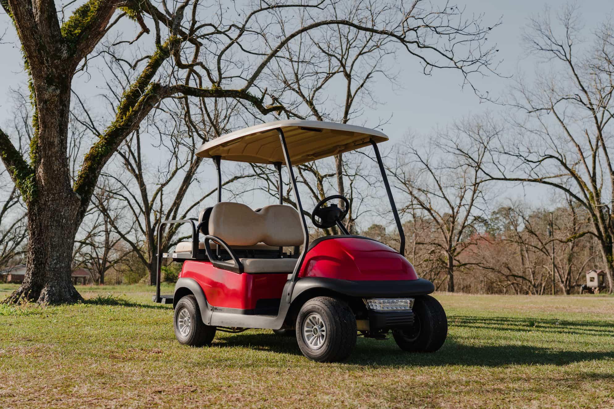 Red 4 seater golf cart in pecan orchard | Statesboro Golf Carts | New & Custom Golf Carts